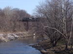 NS 9125 leads a morning westbound over Conneaut creek